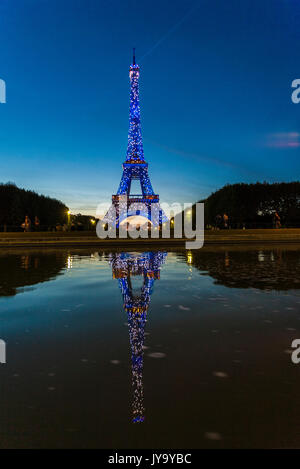 Colored lights illuminate the Eiffel Tower  Champ de Mars Paris France Europe - Stock Photo