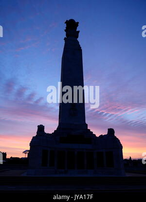 AJAXNETPHOTO. AUGUST, 2017. SOUTHSEA, ENGLAND. - SOUTHSEA WAR MEMORIAL ON CLARENCE ESPLANADE SILHOUETTED AGAINST - Stock Photo