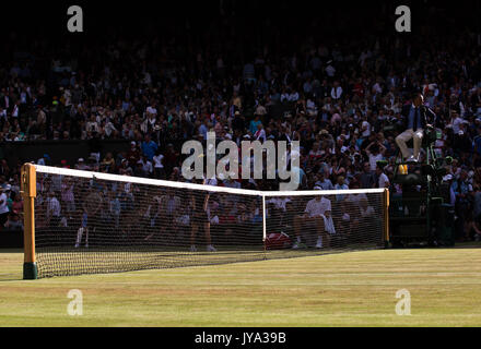 Post and net on Centre Court during the 2017 Wimbledon Tennis Championships, London, Great Britain, United Kingdom. - Stock Photo