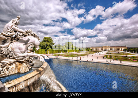 Famous Schonbrunn Palace with fountain in the garden, Vienna, Austria - Stock Photo