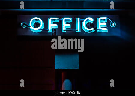 Blue Neon Office Sign - Stock Photo