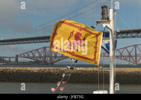 Scottish flags fly in front of iconic Scottish bridges, Firth of Forth, Scotland,  UK