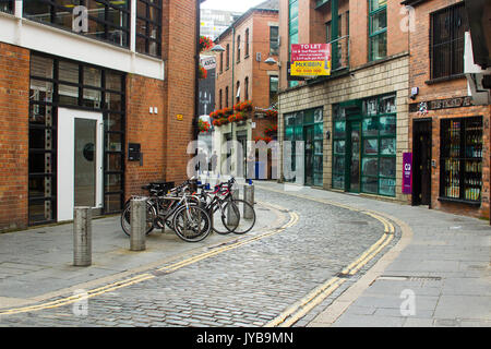 A full cycle stand in a side street in Belfast's popular Cathedral Quarter in Northern Ireland - Stock Photo