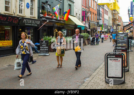 Pedestrians walking through Church Lane in Belfast City centre, Northern Ireland - Stock Photo