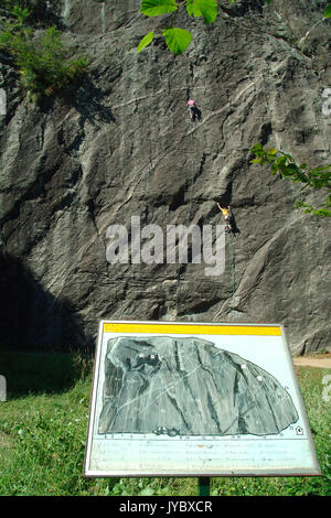 Panels illustrate the climbers about climbing routes plotted on Sasso Remenno boulder known to rock climbers from - Stock Photo
