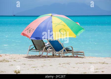 Sunbeds and beach umbrellas at Jolly Beach Caribbean Antigua and Barbuda Leeward Island West Indies - Stock Photo