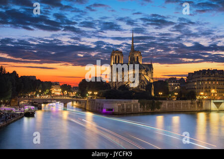 View of the Paris church notre dame at sunset - Stock Photo