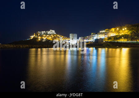 Night view of village on promontory and its medieval tower Castelsardo Gulf of Asinara Province of Sassari Sardinia - Stock Photo
