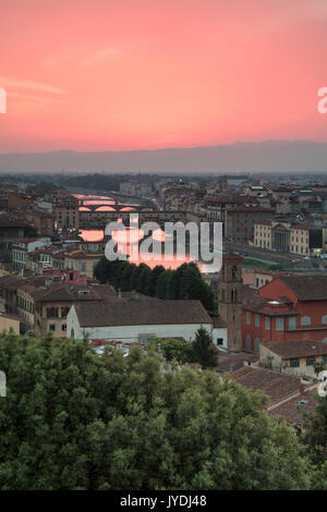 Pink sunset on the Arno River and Ponte Vecchio seen from Piazzale Michelangelo Florence Tuscany Italy Europe - Stock Photo