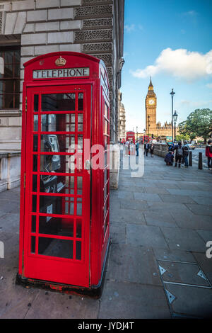 Typical british red telephone box with Big Ben in the background London United Kingdom - Stock Photo
