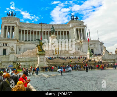 Rome, Italy - May 03, 2014: Tourists going at Piazza Venezia and Victor Emmanuel II Monument in Rome, Italy on June - Stock Photo