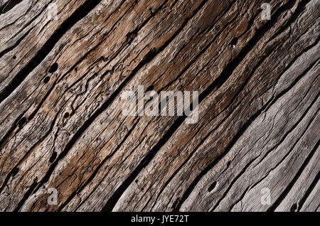 Texture - old gray rotten wooden board with deep cracks and wavy grooves. Horizontal photo, wallpaper - Stock Photo