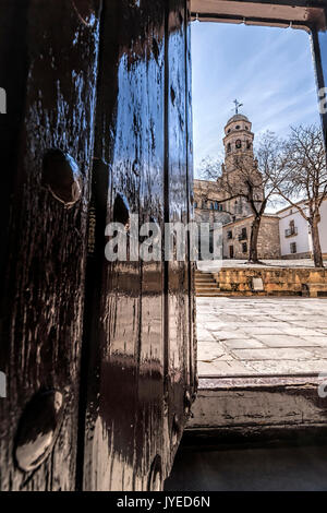 Baeza, Jaen province, SPAIN - 9 march 2014: Cathedral in the Plaza Santa Maria , detail of Bell Tower taken from - Stock Photo