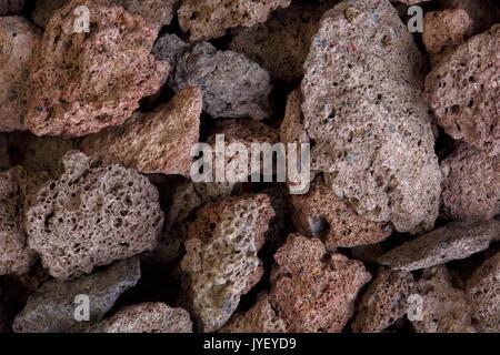 Macro photo of red volcanic lava stones. High resolution photo. - Stock Photo