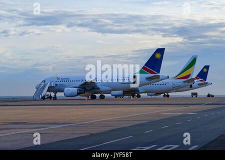 Airplanes on  forefield of Hosea Kutako Airport in Windhoek, Namibia - Stock Photo