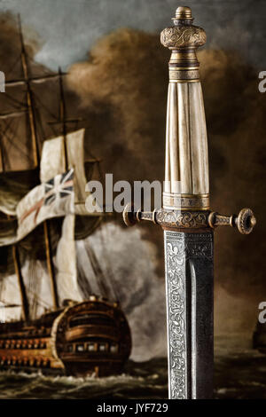 Creative photo of an ancient carved sword against painted background. - Stock Photo