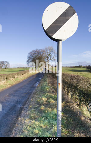 National Speed Limit Sign on Narrow country Road - Stock Photo