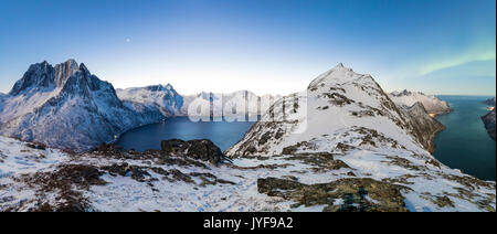 Panoramic view of the icy sea along the Mefjorden to Ornfjorden towards the peak of Mount Barden Senja Tromso Norway - Stock Photo
