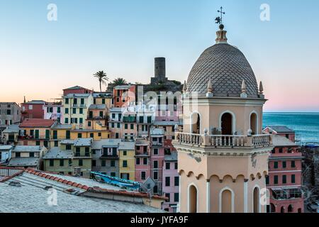 A detail of the church of Vernazza, one of the prettiest village of the Cinque Terre. In the background, pastel - Stock Photo