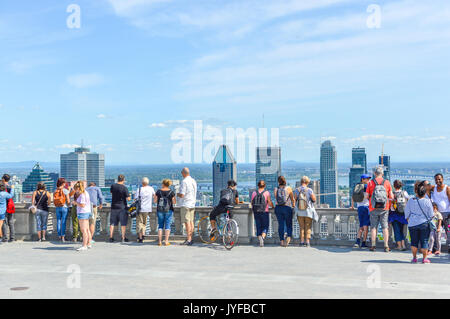 Montreal, Canada - August 16,, 2017: Many tourists are standing on Kondiaronk Belvedere to enjoy Montreal skyline. - Stock Photo