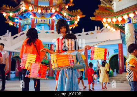 Kuala Lumpur, Malaysia - September 15, 2016:  Little girls pose with paper lanterns at Thean Hou Temple at the lantern - Stock Photo