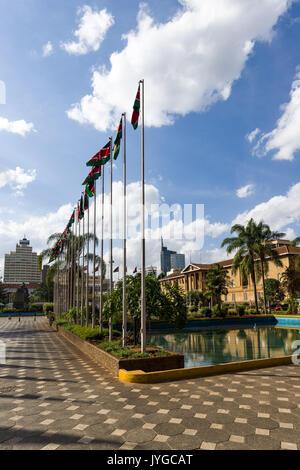 Kenyatta International Convention Centre square with Kenyan flags, Nairobi, Kenya - Stock Photo