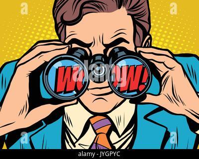 wow Businessman looking through binoculars - Stock Photo