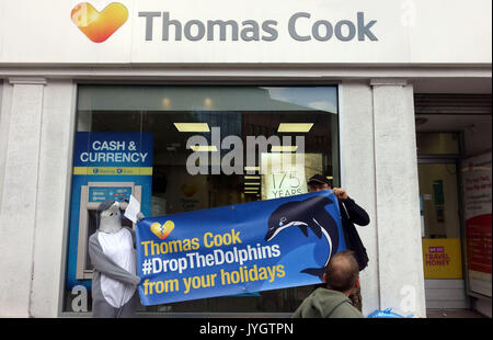 London, UK. 19th August, 2017.  Activists from Dolphin Freedom UK protest outside branch of Thomas Cook travel agents - Stock Photo