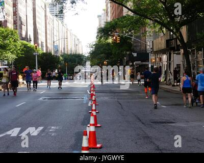 New York City, USA, 19 August, 2017. New Yorkers bike, run, walk and play on Park Avenue, enjoying the last of three - Stock Photo