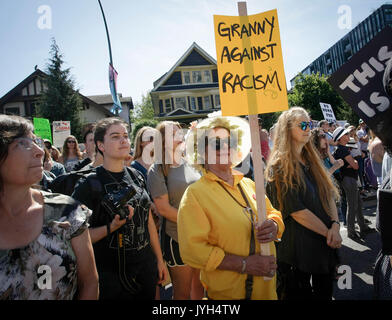 Vancouver, Canada. 19th Aug, 2017. A protestor carries a sign during an anti-racism rally outside Vancouver City - Stock Photo