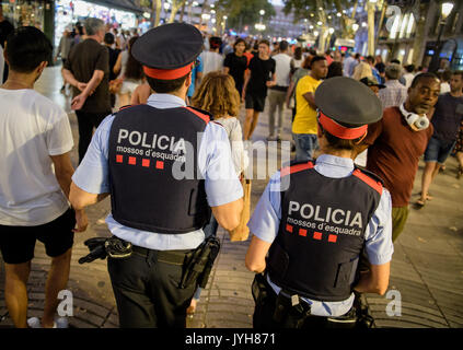 Barcelona, Spain. 19th Aug, 2017. Police patrol the Las Ramblas in Barcelona, Spain, 19 August 2017. Several people - Stock Photo