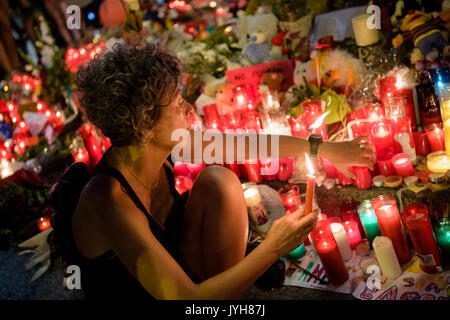 Barcelona, Spain. 19th Aug, 2017. Flowers in the Las Ramblas in Barcelona, Spain, 19 August 2017. Several people - Stock Photo