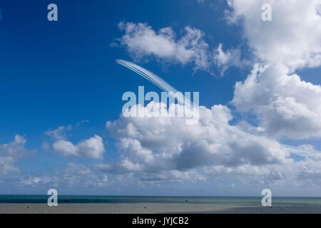 RAF Red Arrows aerobatic display team performing precision flying over the English Channel at Airbourne 2017, England. - Stock Photo