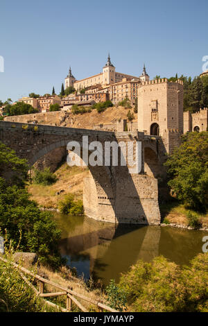 View of the Alcantara bridge over the river Tagus towards the medieval city of Toledo Spain with the Alcazar in - Stock Photo