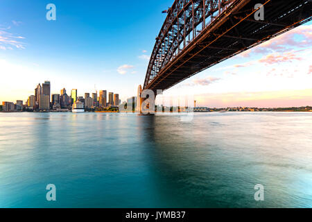 Sydney skyline and harbor bridge during sunrise, New South Wales Australia - Stock Photo