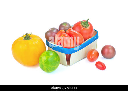 Assortment organic vegetable colorful tomatoes isolated on white background - Stock Photo
