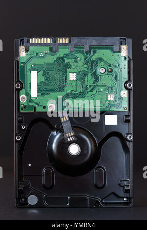 sata hdd hard disc drive on black background closeup. - Stock Photo