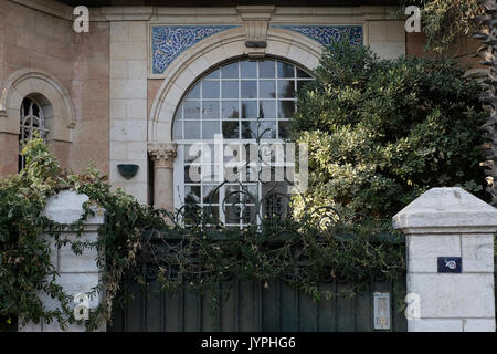 Facade of the former Arab villa of Dajani family located in 24 Hatzfira street in Katamon or Qatamon neighborhood - Stock Photo
