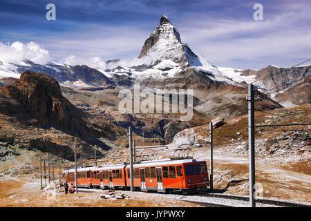 Famous Matterhorn peak with Gornergrat train in Swiss Alps, Switzerland - Stock Photo