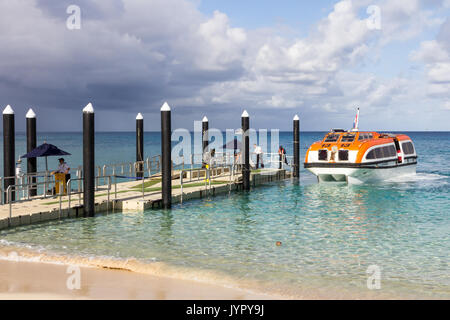 Tender from the Holland America line cruise ship arriving at the dock on Dravuni island, Fiji - Stock Photo