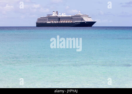 The Holland America line cruise ship Oosterdam anchored off the Dravuni island, Fiji, South Pacific - Stock Photo