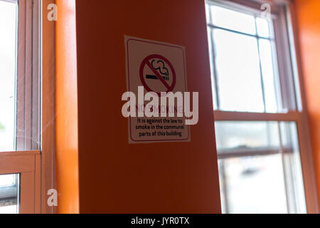 No Smoking sign on wall in stairwell of flats, London. - Stock Photo