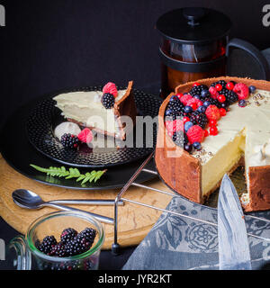 White chocolate mousse cake on a dark background. - Stock Photo