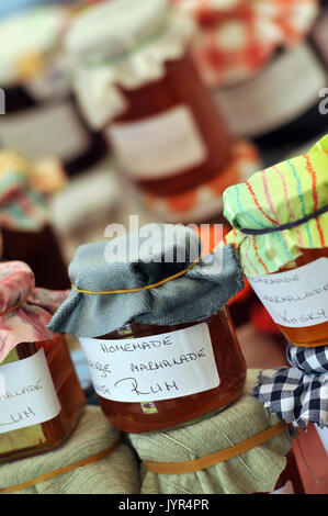 jams preserves and oils honey and relish spirits  on sale at a festival for garlic on the isle of wight tipsy sugary - Stock Photo
