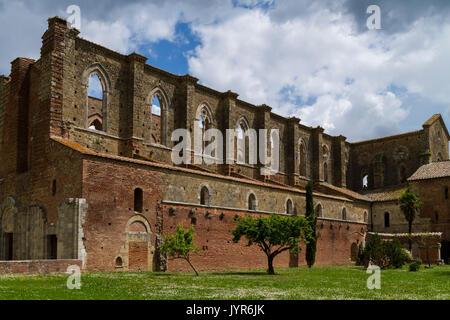 View of the roofless cistercian abbey of San Galgano, near Chiusdino, Siena district, Tuscany, Italy. - Stock Photo