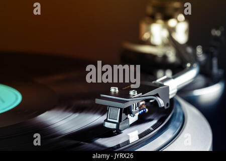 vintage turntable in action close up - Stock Photo