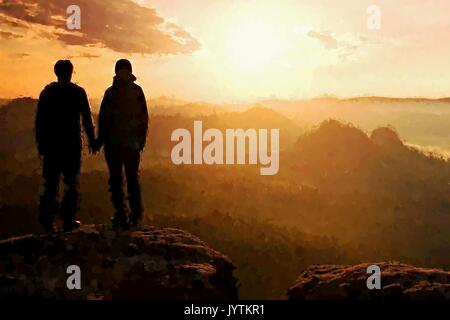 Watercolor paint. Paint effect.  Couple enjoying marvelous moments during sunset . Young pair of hikers on the peak - Stock Photo