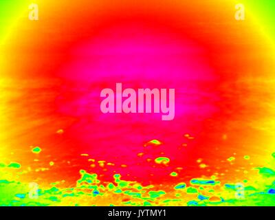Thermography measurement, changed colors of ultra violet light. Stony ocean beach with big boulders. Thermography - Stock Photo