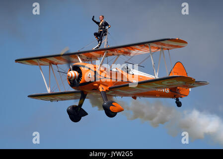 Breitling Wingwalkers at Biggin Hill Festival of Flight airshow. Space for copy - Stock Photo