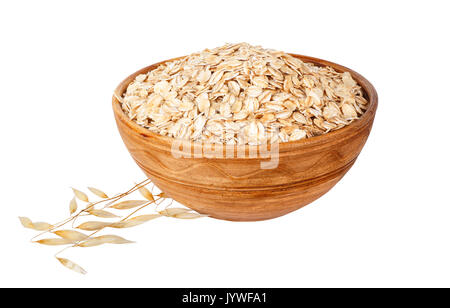 oat flakes in bowl and ripe oat ears isolated on white background. Uncooked oatmeal - Stock Photo